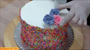 Applying roses to cake