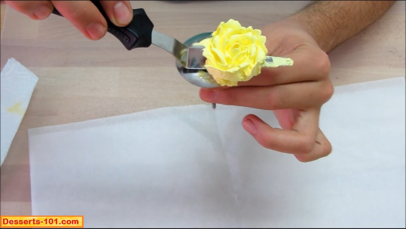 Lifting buttercream rose off of flower nail.