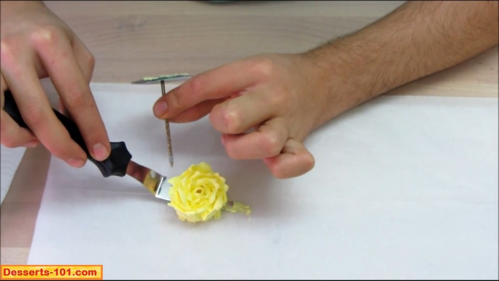 Showing the tip of the flower nail to help transfer the rose to the parchment paper
