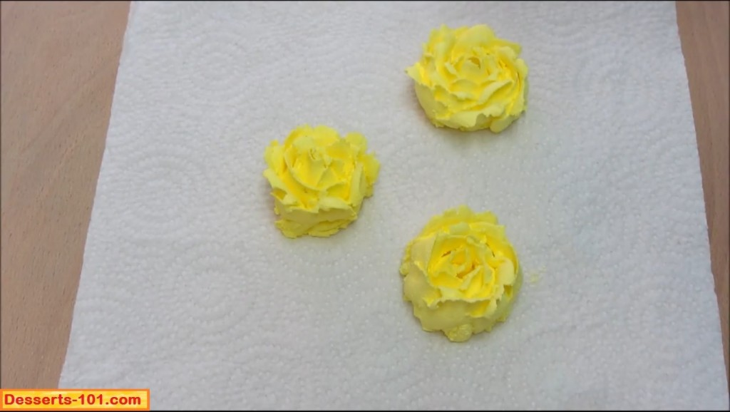 Place frozen buttercream roses on top of cake.