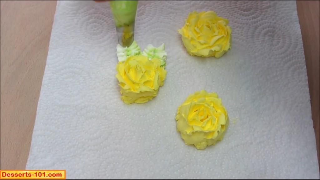 Adding leaves to buttercream roses