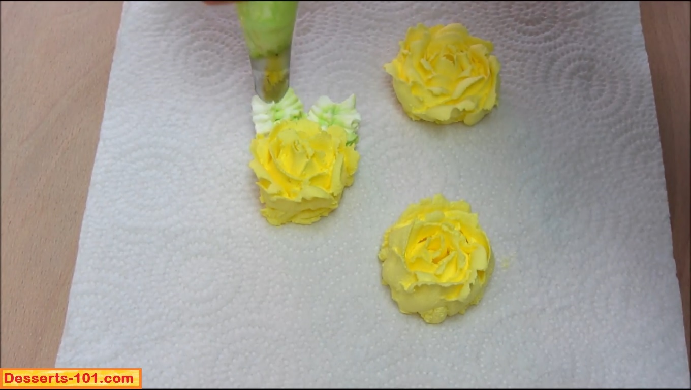 Adding leaves to buttercream roses