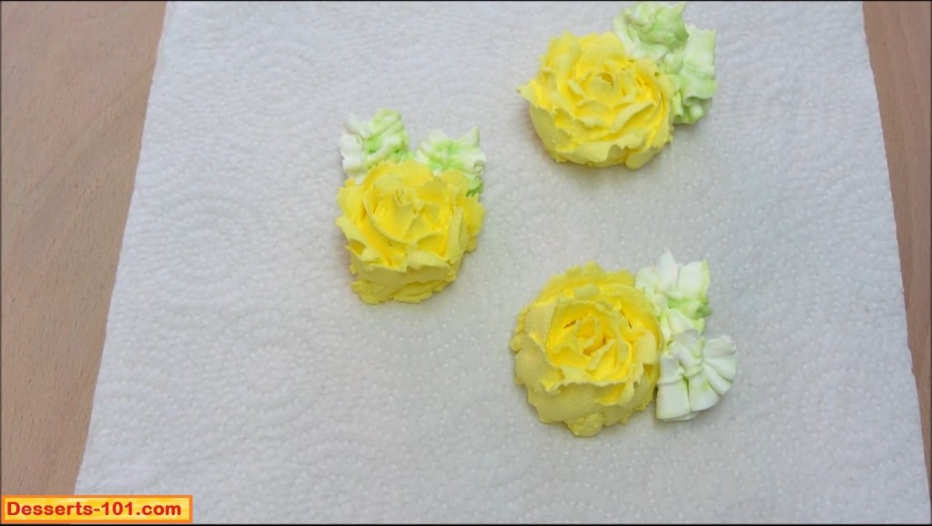 Buttercrea roses with leaves.