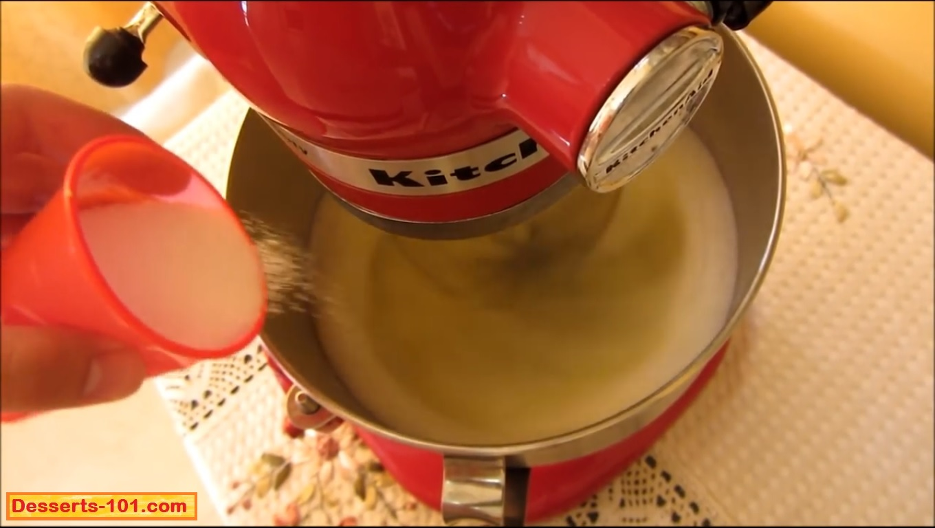 Once the eggs whites have become frothy,slow add the 1/2 cup granulated sugar.