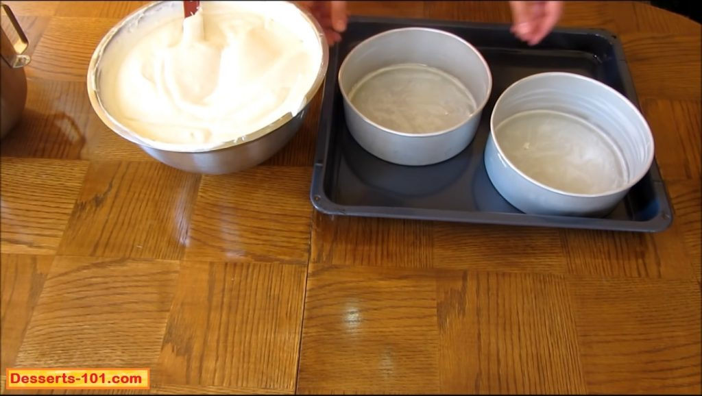 Pour the cheesecake batter into prepared baking pans.
