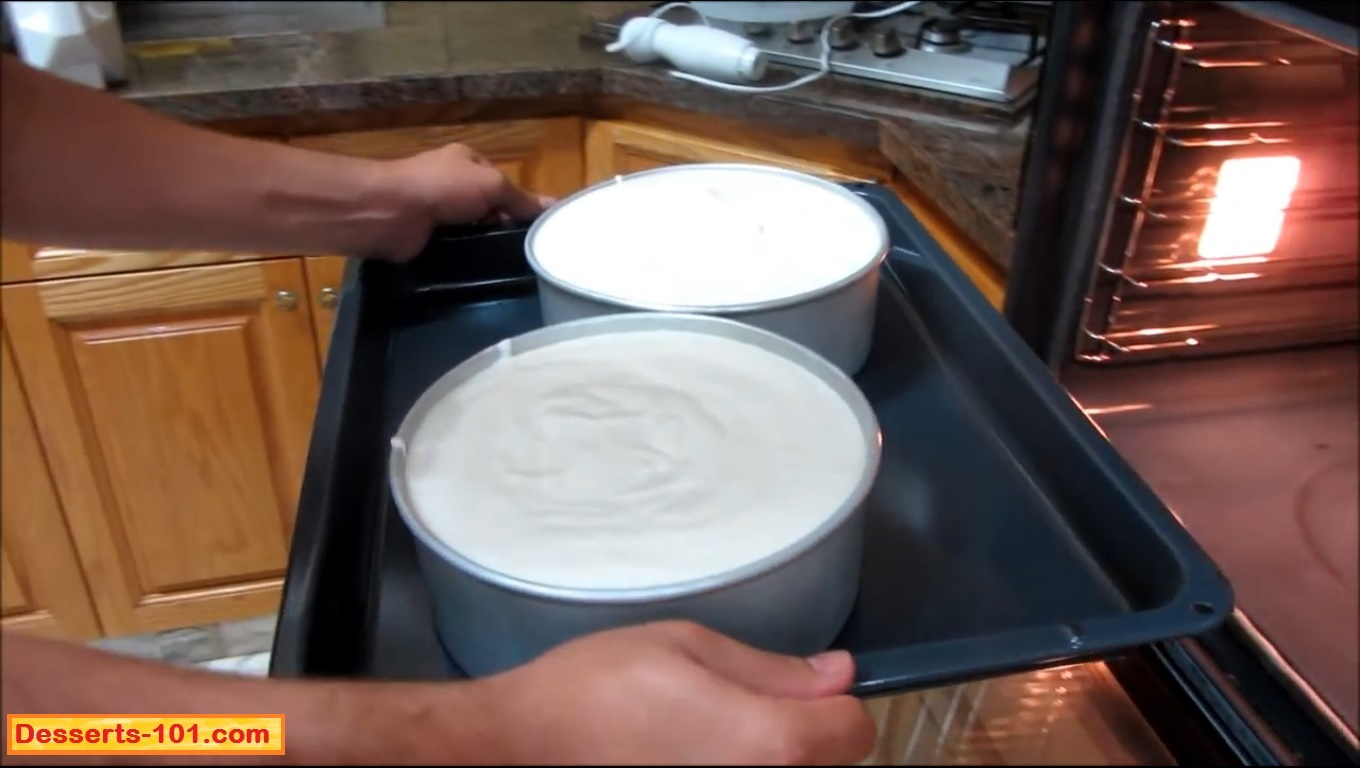 Place the pan into a larger pan and place in a preheated oven.