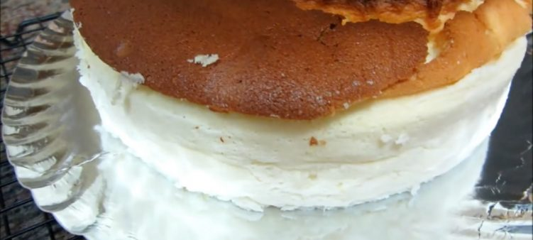 The cheesecake has been cooled completely before being placed on a serving plate.