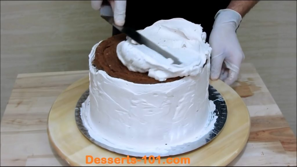 Icing the top of the cake.